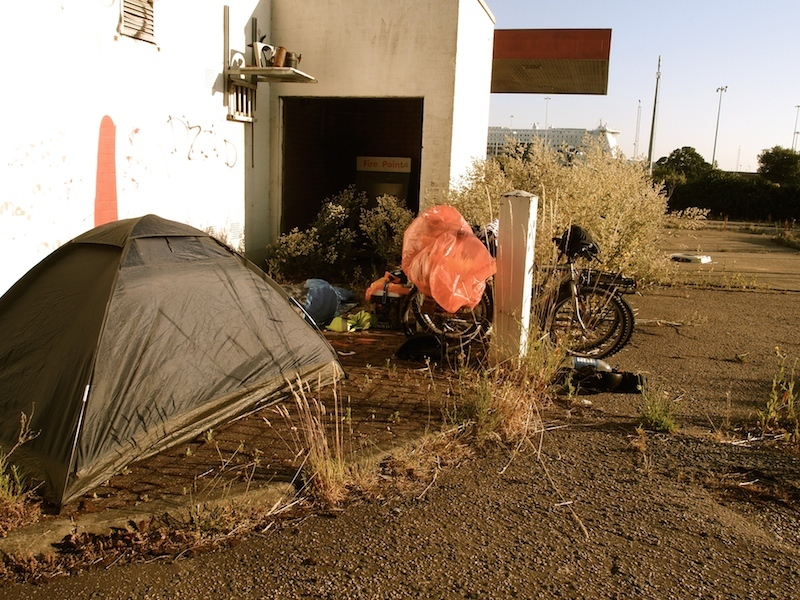 Day 3: After being turned away from the ferry terminal, we slept at an abandoned gas station across the street, England