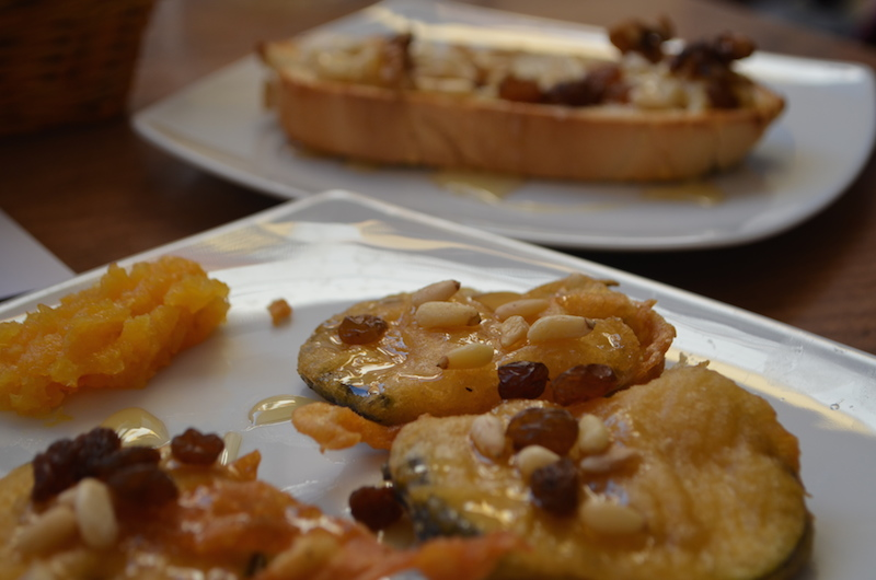 Light-fried eggplant with pine nuts, sultanas, and orange, Toasted baguette with warm camembert and walnuts
